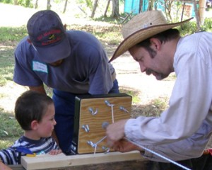 Darin making rope with cousins Dean and Troy at the Greet Ranch Centennial